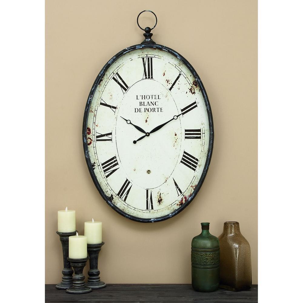 Litton Lane 37 in. x 23 in. Metal Wall Clock 53306