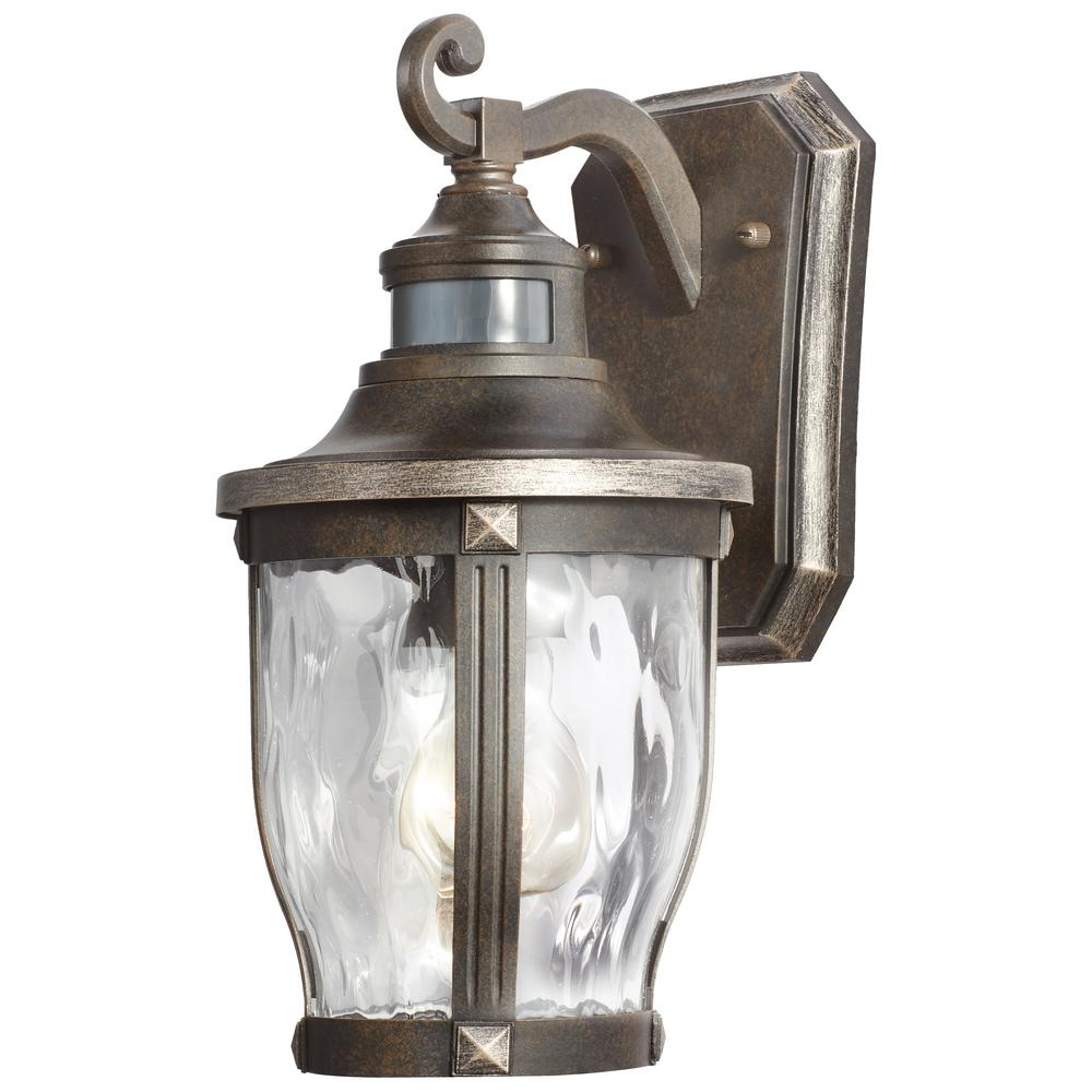Home decorators collection mccarthy 1 light bronze with gold home decorators collection mccarthy 1 light bronze with gold highlights outdoor motion sensor wall lantern 22411 the home depot aloadofball Choice Image