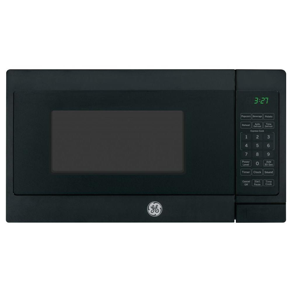 GE 0.7 cu. ft. Small Countertop Microwave in Black GE appliances provide up-to-date technology and exceptional quality to simplify the way you live. With a timeless appearance, this family of appliances is ideal for your family. And, coming from one of the most trusted names in America, you know that this entire selection of appliances is as advanced as it is practical. Color: Black.