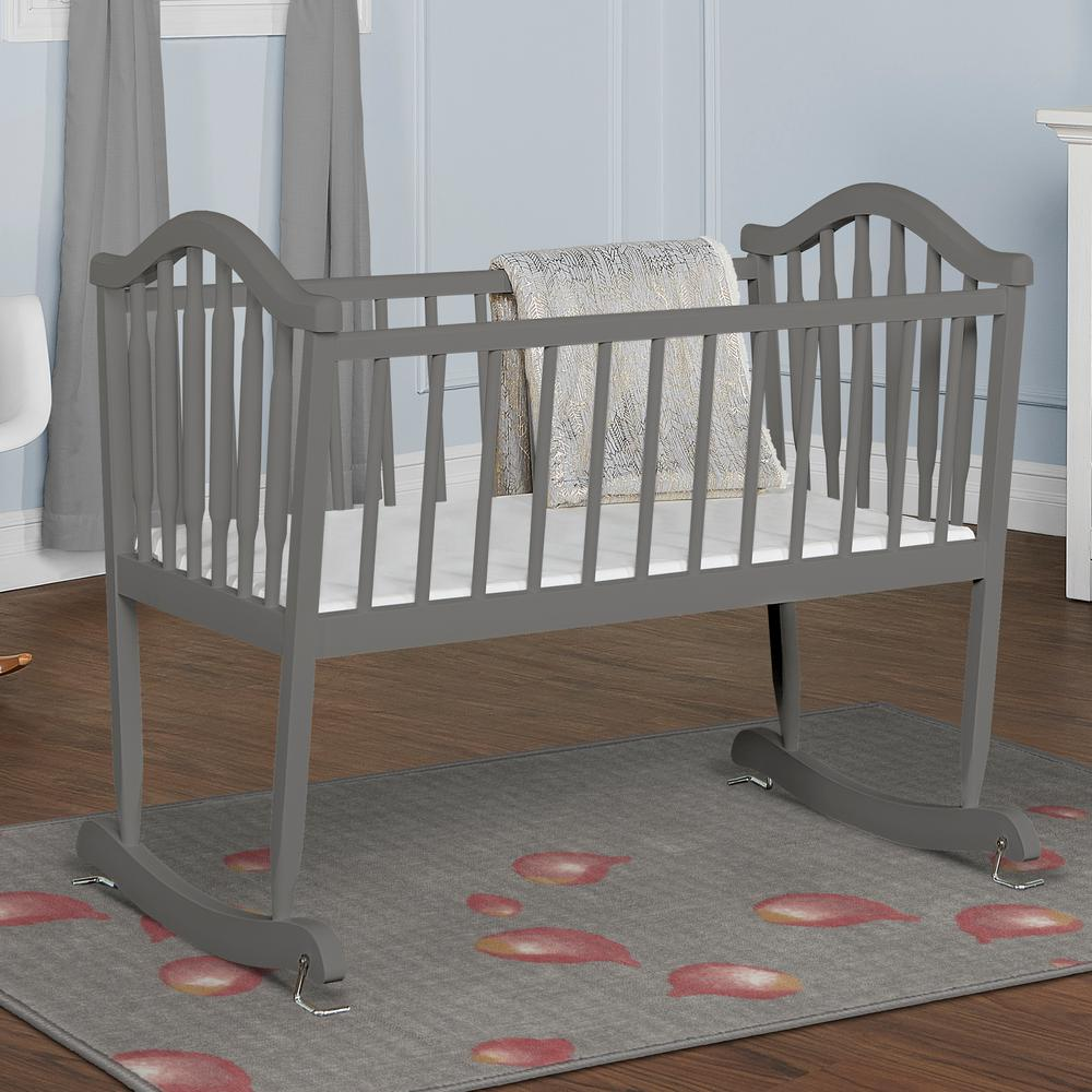 Dream On Me Steel Grey Rocking Cradle Dream On Me, Rocking Cradle 645, is attractively design with arched head and footboards. Features include slumber pad and gentle swinging motion rocks baby to sleep. The cradle can also be made stationary using the simple support pin on one side of the cradle. Recommended for use with newborns to 20 lbs. or until your baby can roll from side to side or push up. Color: Steel Grey.
