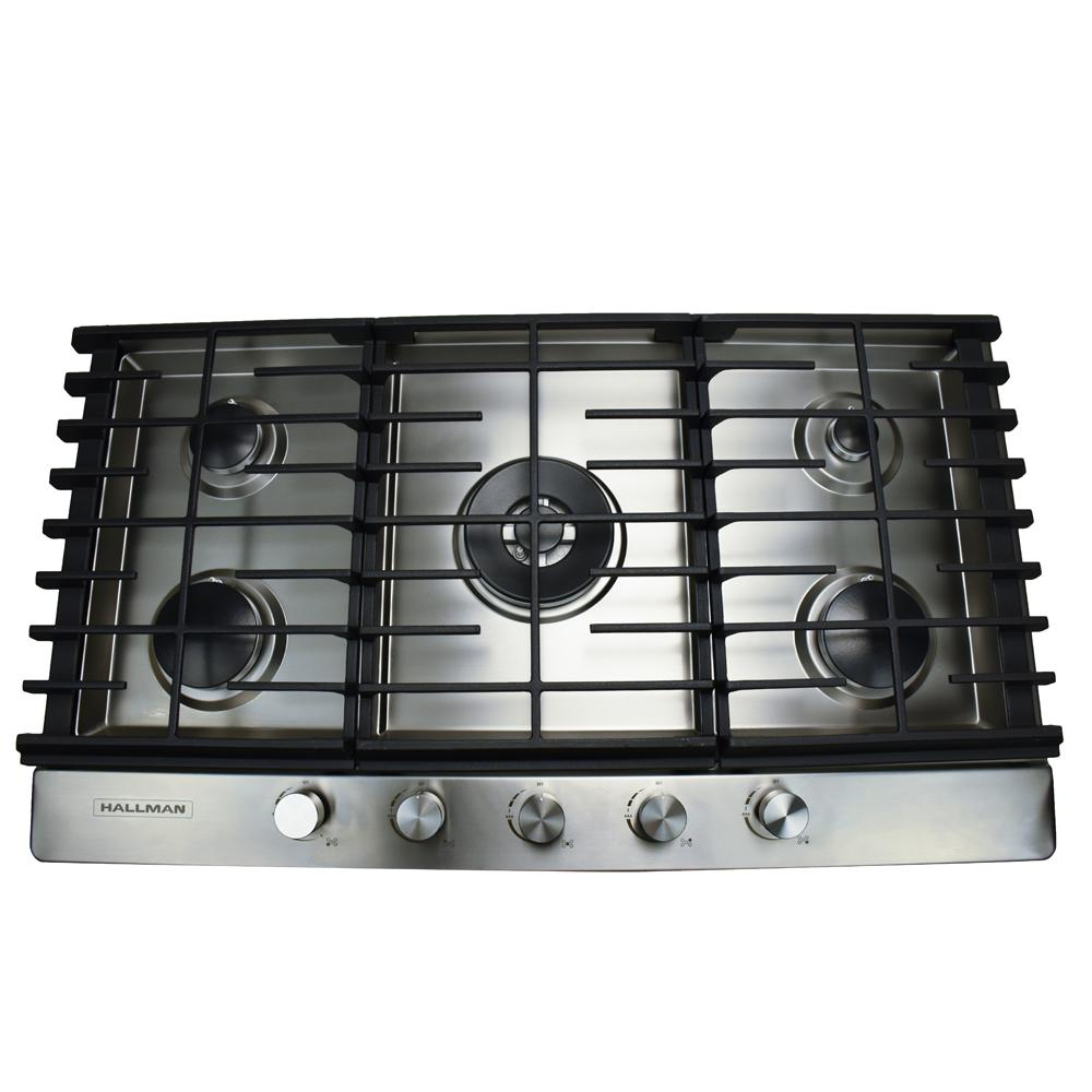 Hallman 36 in. Gas Cooktop in Stainless Steel with 5 Burners Including a Tri-Ring Power Burner, Silver The Hallman cooktop marries elegant, space-saving design with impeccable cooking performance all at a great price. Its Italian-made Sabaf burners, ranging in size from 17,000 BTUs down to under 3,400 BTUs, so whether you need a gentle simmer or a rapid boil you can get just the right heat to provide you with a perfect blend of power and precision. Multi-prong continuous cast iron grates provide a single cooking surface (for safety and ease of pot movement). Available in 3 sizes Hallman cooktops beautifully compliment all ovens and hoods in color and design, while delivering powerful cooktop performance with a total BTU load of 46,800 BTU. The stylish design of Hallman Professional Gas Cooktops are a great choice to give the kitchen a modern-contemporary decor. Color: Stainless Steel.