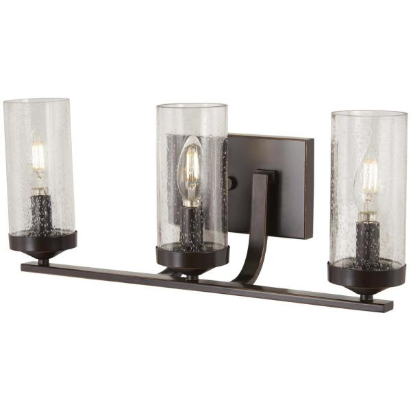 Elyton 3-Light Downtown Bronze with Gold Highlights Bath Light with Clear Seedy Glass