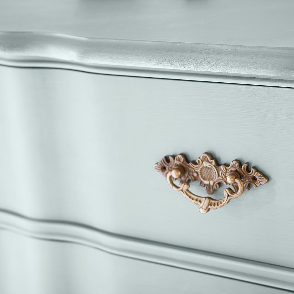 Detail of antique blue chalk paint from Home Depot applied to a vintage dresser for a timeless tranquil look.