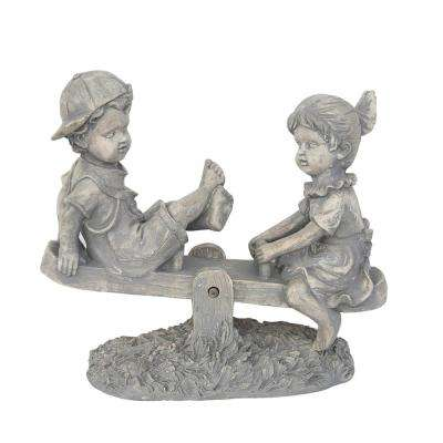 11-1/2 in. Boy and Girl Playing on Seesaw Statue