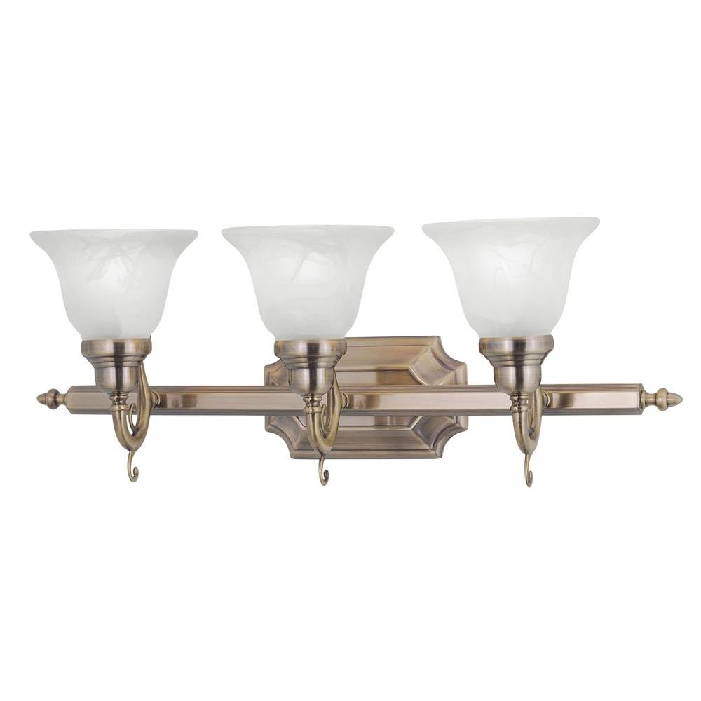 brass bathroom lights livex lighting 3 light antique brass bath light with white 12156