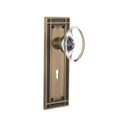 Mission Plate with Keyhole 2-3/4 in. Backset Antique Brass Privacy Oval Clear Crystal Glass Door Knob