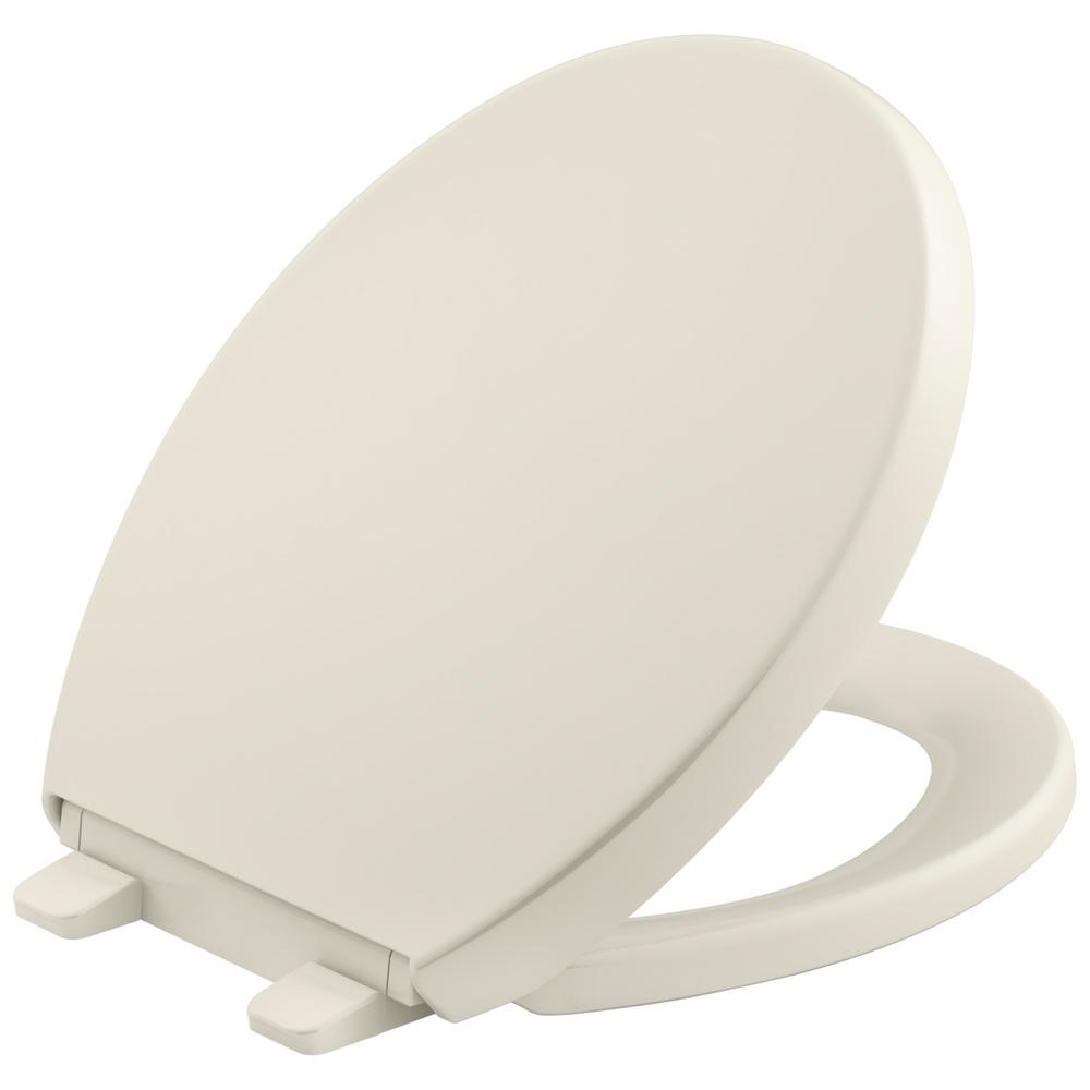 KOHLER Grip Tight Reveal Q3 Round Closed Front Toilet Seat in Biscuit