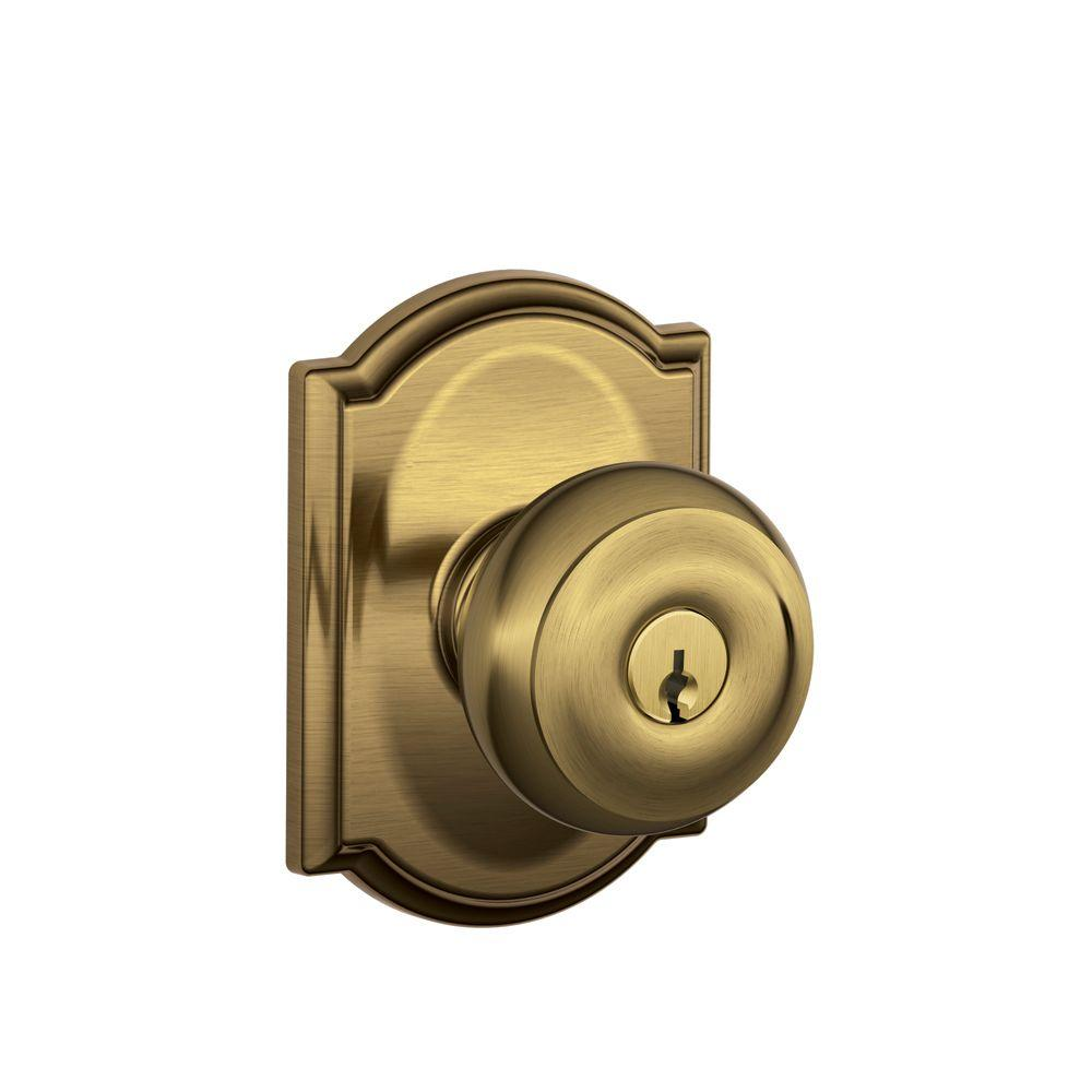 Schlage georgian antique brass entry door knob with for Exterior door knobs