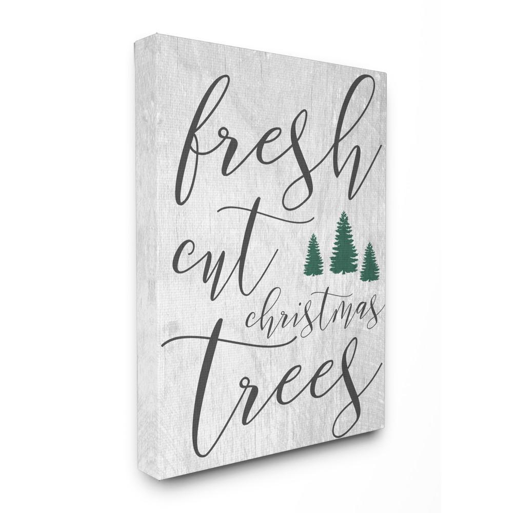 fresh cut christmas trees grey