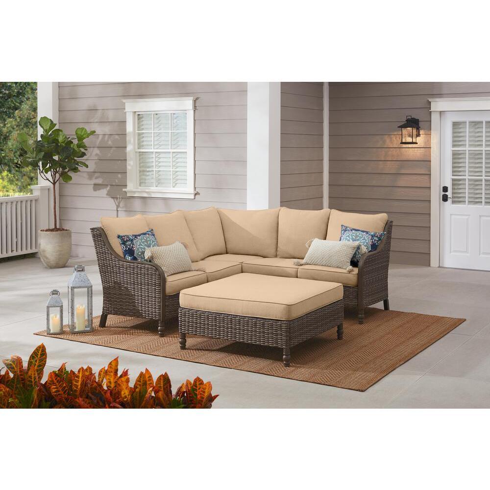 4-Piece Hampton Bay Windsor Brown Wicker Outdoor Patio Sectional Sofa with Ottoman and Sunbrella Beige Tan Cushions