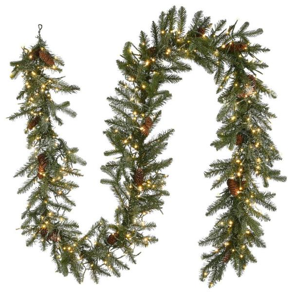 9 ft. Feel Real Snowy Morgan Spruce Garland with Cones and 400 Dual Color LED Cosmic Lights
