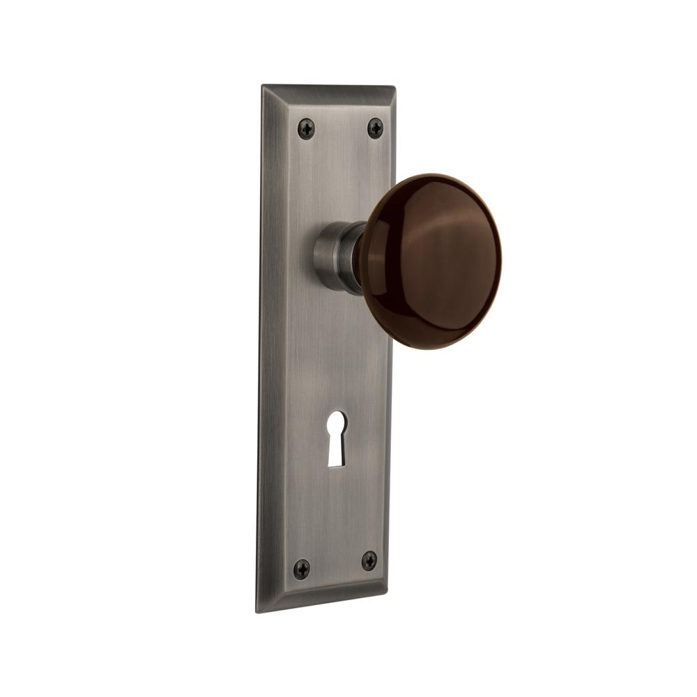 Nostalgic Warehouse New York Plate with Keyhole Single Dummy Brown Porcelain Door Knob in Timeless Bronze