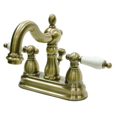 Victorian Porcelain Lever 4 in. Centerset 2-Handle Bathroom Faucet in Vintage Brass