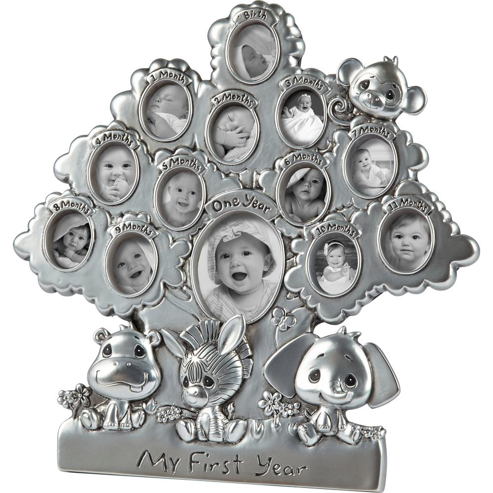 Precious Moments Precious Paws 1 in. x .75 in. My First Year Silver Resin Picture Frame Collage An adorable monkey sits at the top of this tree-shaped first year photo frame while his Precious Paws pals rest happily near the base, Holds 12 monthly photos and a first birthday picture. New parents will adore this thoughtful way to commemorate all the milestones of baby's first year. Adds a delightfully memorable touch to nursery or home decor . Bring this lovely gift to a baby shower a new baby welcome or for a baby's first birthday party, Silver tone makes it easy to place in just about any baby room decor scheme. Carefully crafted with cold-cast resin. Approximately 8 in. H x 8 in. W First Birthday Oval: 2 in. H x 1.5 in. W First 12 Month Ovals 1 in. H x .75 in. W