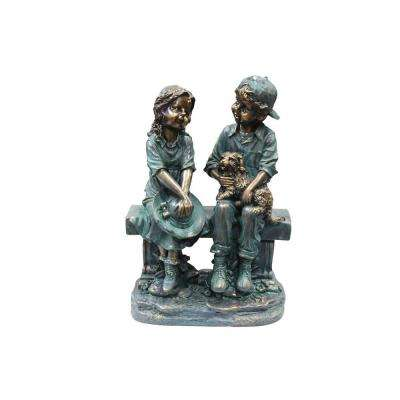 Girl and Boy Sitting on Bench with Puppy Statue