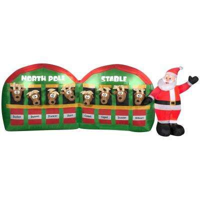 10.99 ft. W Pre-lit LED Inflatable Santa in Stable with 8 Reindeers Airblown