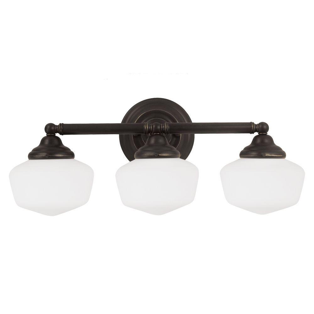 Sea gull lighting academy 3 light heirloom bronze wall - Schoolhouse bathroom vanity light ...