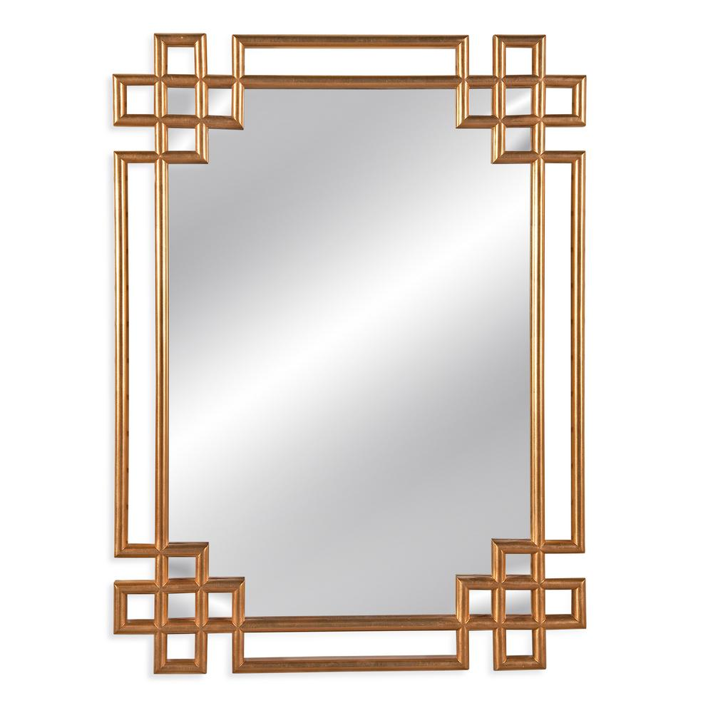 BASSETT MIRROR COMPANY Frederick Decorative Wall Mirror Classic Greek Key goes geometric. This antiqued gold leaf from our Old World collection is at home in a contemporary or traditional setting. Adds sophistication to any room setting.