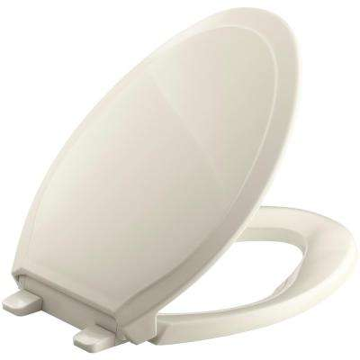 Rutledge Quiet-Close Elongated Toilet Seat with Grip-Tight Bumpers in Almond