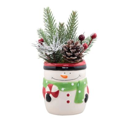 6 in. H Christmas Arrangement in Ceramic Traditional Snowman Pot with Pinecones and Berries