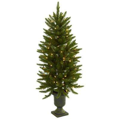 artificial christmas tree with urn and clear lights