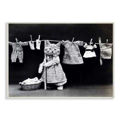 """12.5 in. x 18.5 in. """"Kitten Does The Laundry"""" by Daphne Polselli Printed Wood Wall Art"""