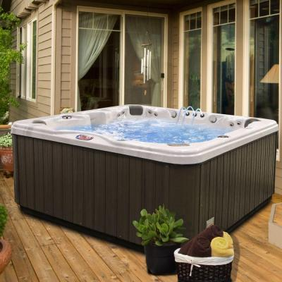 7-Person 56-Jet Premium Acrylic Bench Spa Hot Tub with Bluetooth Stereo System, Subwoofer and Backlit LED Waterfall