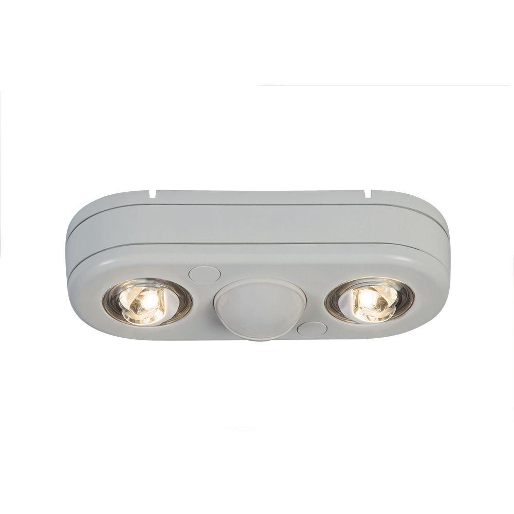 Revolve 180-Degree White Twin Head Motion Activated Outdoor Integrated LED