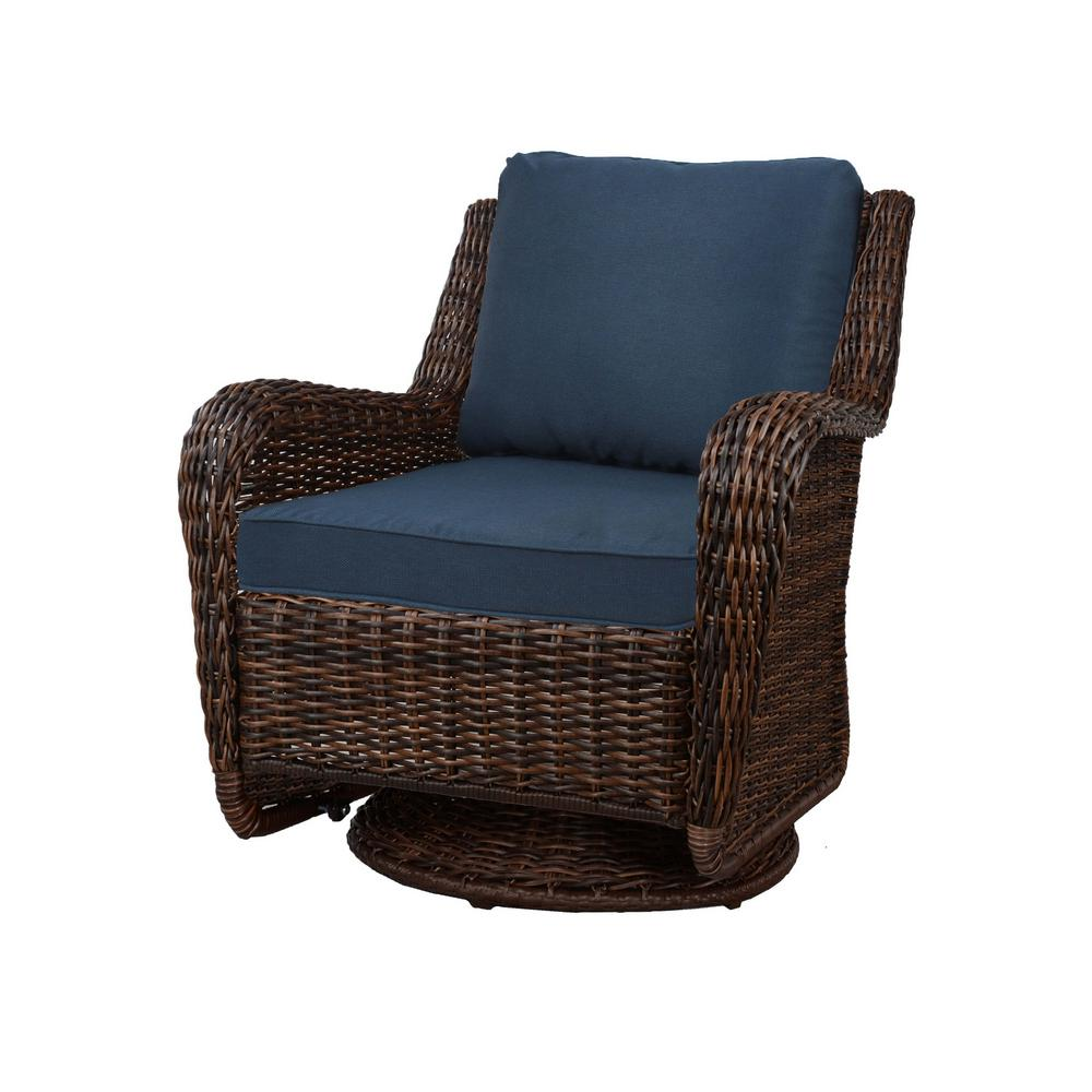 Hampton bay cambridge brown wicker swivel outdoor rocking chair with blue cushions