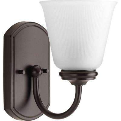Keats Collection 1-Light Antique Bronze Bath Sconce with Frosted Ribbed Glass Shade