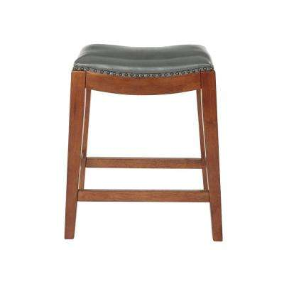 Metro 24 in. Pewter Bonded Leather Saddle Stool with Nail Head Accents and Espresso Legs