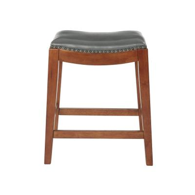 Metro 23.75 in. Pewter Bonded Leather Saddle Stool with Nail Head Accents and Espresso Legs