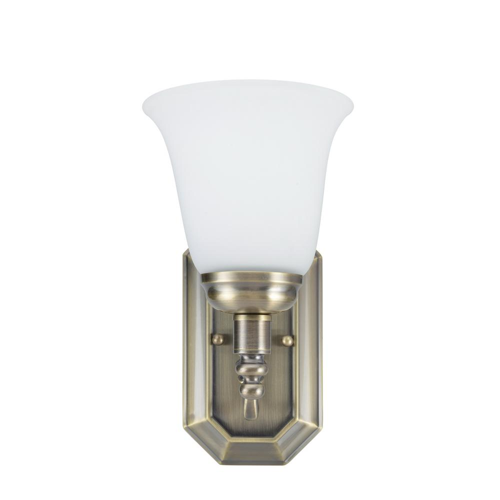 Aspen Creative Corporation 1-Light Antique Brass Vanity Light with Frosted Glass Shade