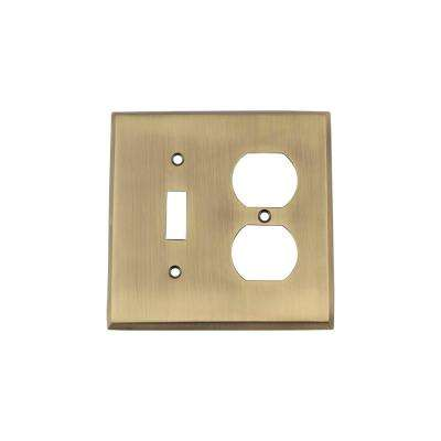New York Switch Plate with Toggle and Outlet in Antique Brass