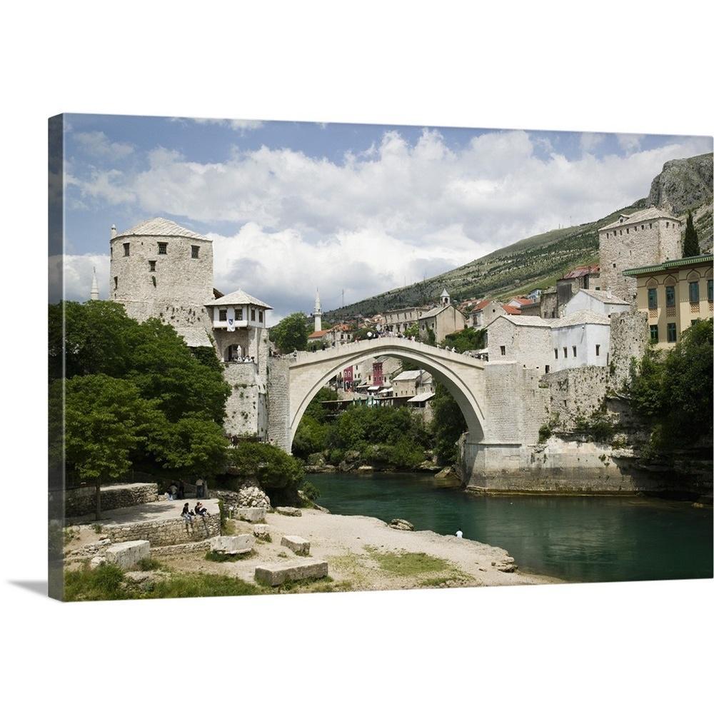 ''Bosnia Hercegovia, Mostar, The Old Bridge Stari Most'' by Walter Bibikow Canvas Wall Art