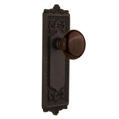 Egg and Dart Plate 2-3/8 in. Backset Oil-Rubbed Bronze Privacy Brown Porcelain Door Knob