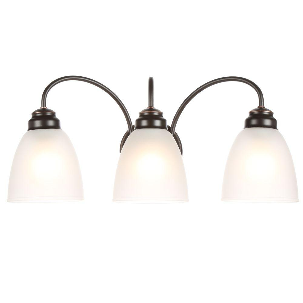 Hampton Bay Hamilton 3 Light Oil Rubbed Bronze Vanity Light With Frosted Glass Shades Efg1393al 2 Orb The Home Depot