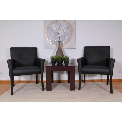 Designer Guest Chair. Black Vinyl. Black Finish. Comfort Cushions.