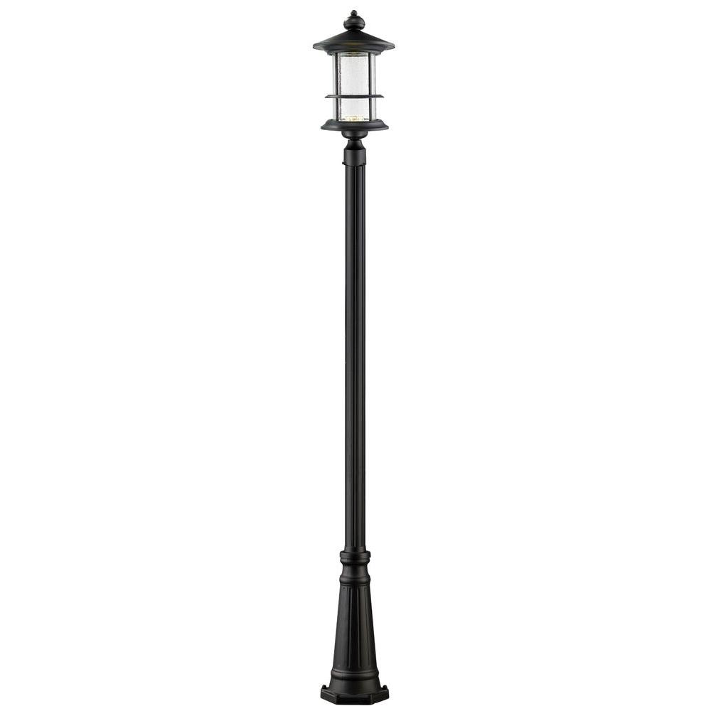 Post lighting outdoor lighting the home depot burnim 1 light outdoor black integrated led lamp post with clear seedy aloadofball Images