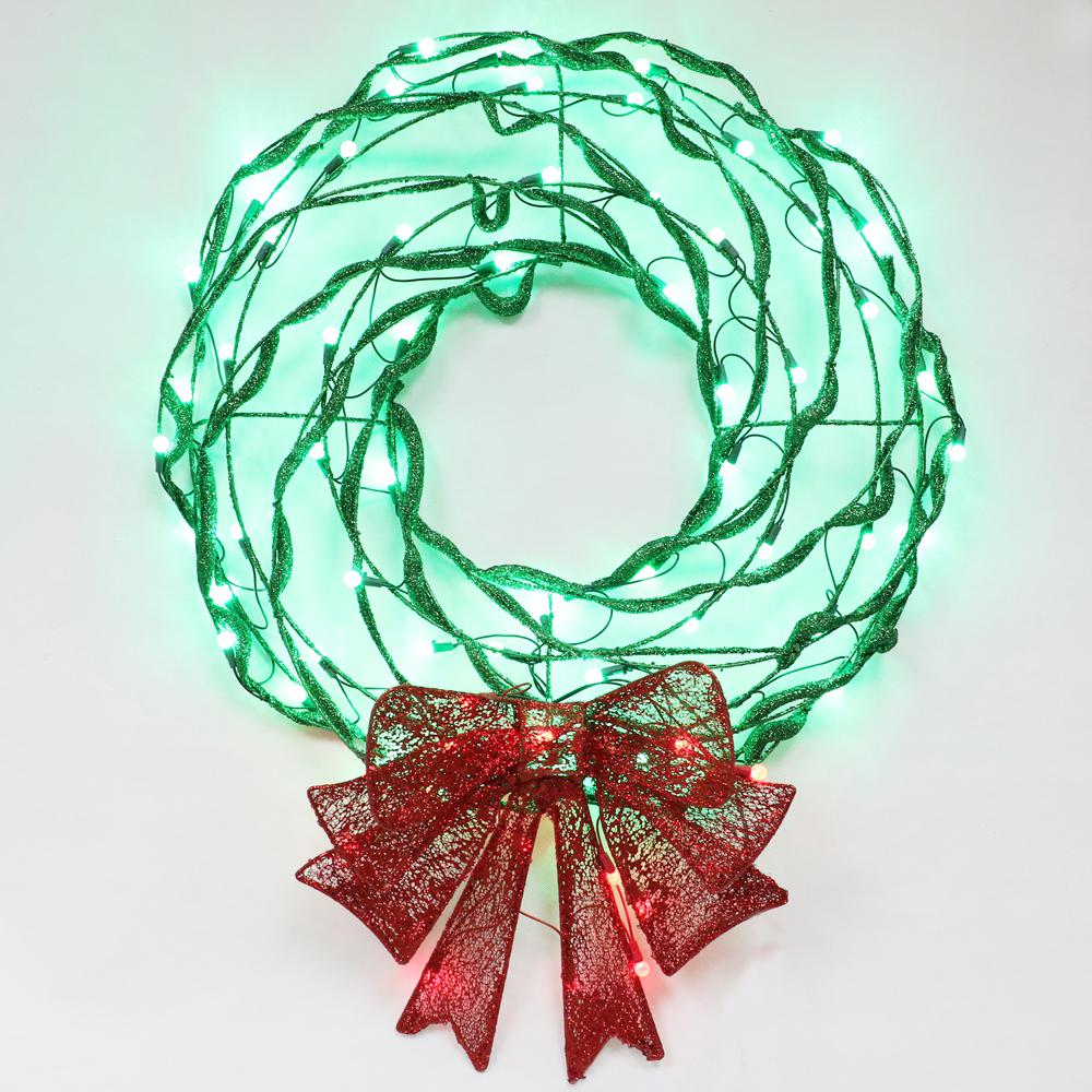 christmas plastic tubed lighted wreath with glitter bow