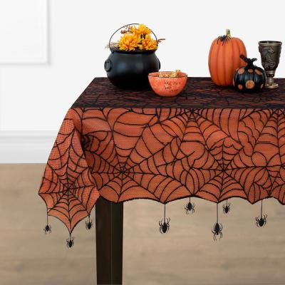 Crawling Halloween Spider 70 in. Round Black/Orange Lace Lined Tablecloth