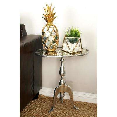 silver oval side table with beige mosaic designed table top and 3pronged stand