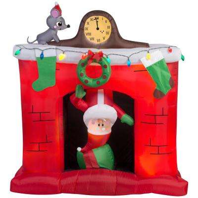 5 ft. W x 5.6 ft. H  Inflatable Santa's Head Popping Down at Fireplace Scene