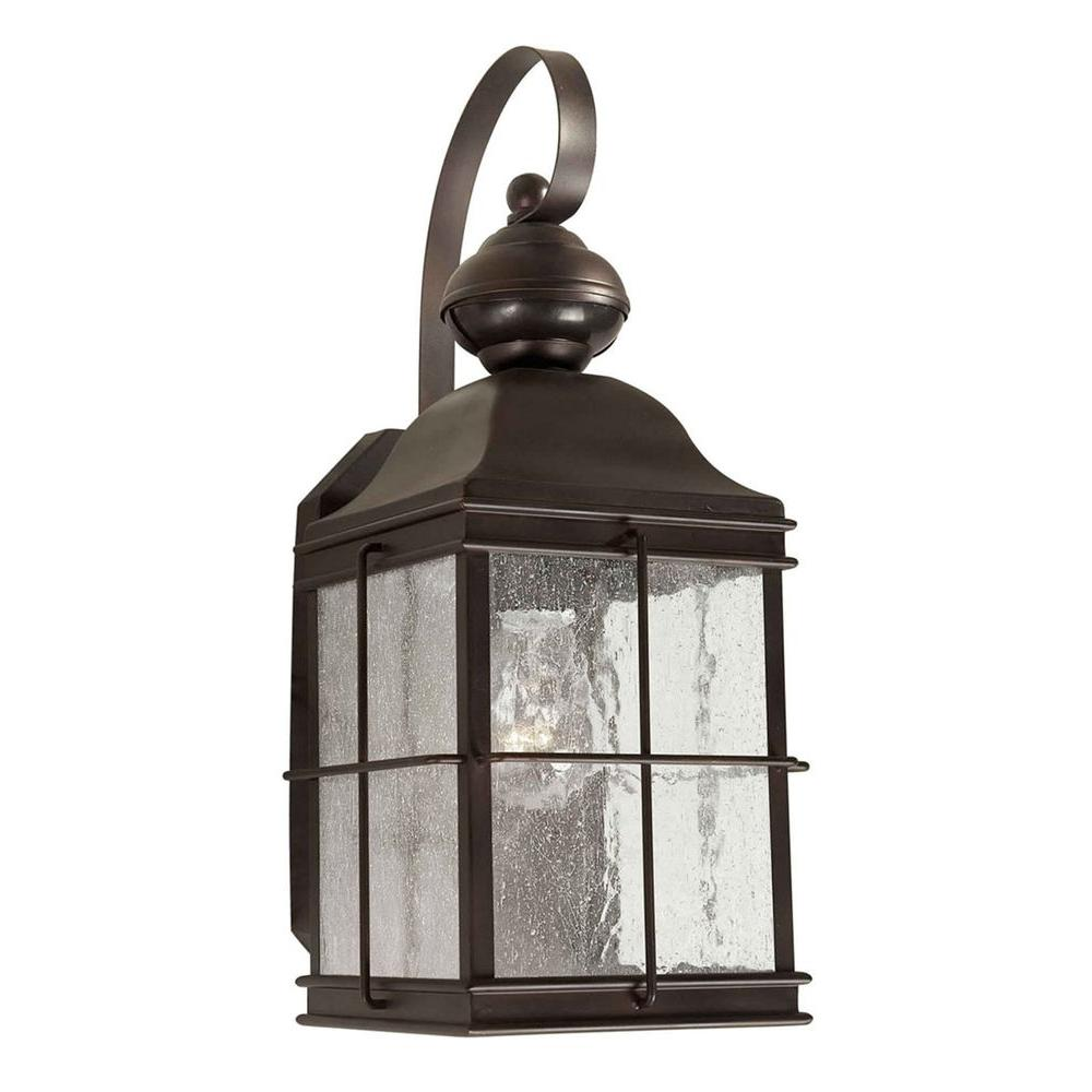 Talista 1-Light Antique Bronze Outdoor Wall Lantern with Clear Seeded Glass Panels