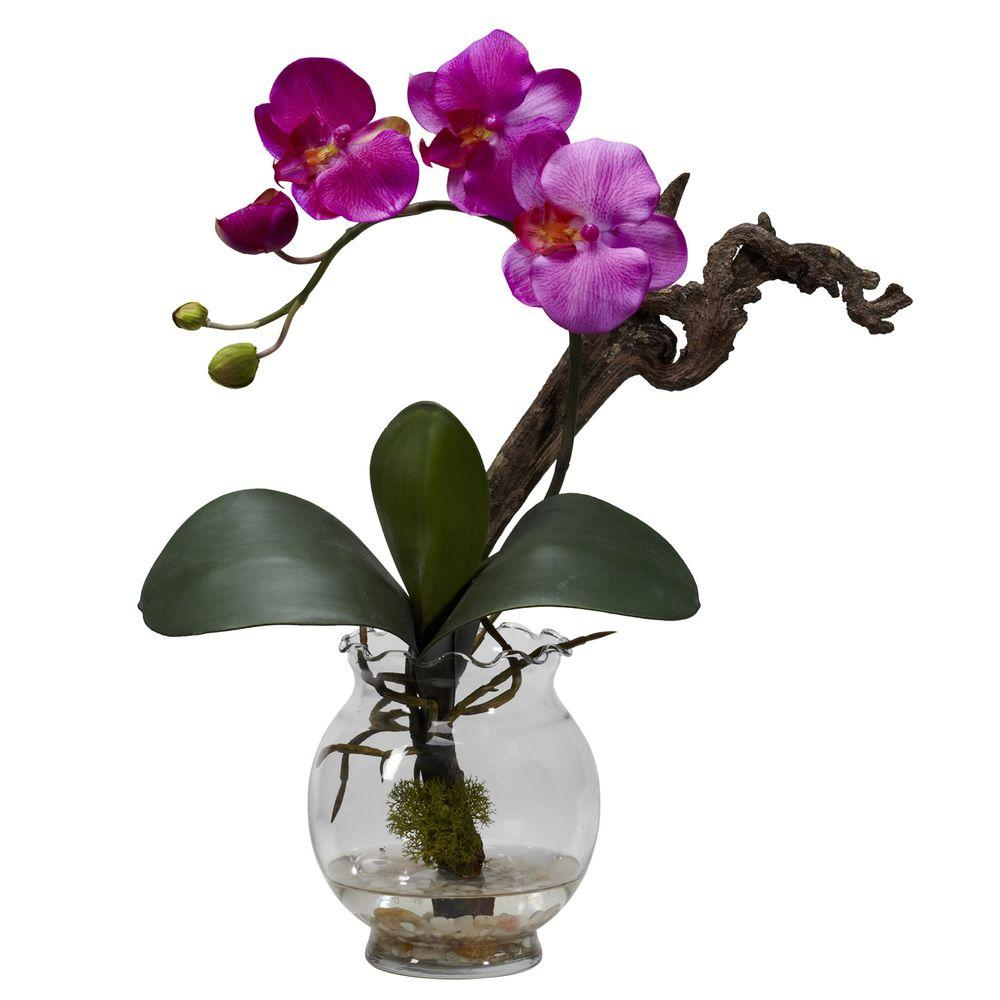 Nearly Natural 15 in. H Purple Mini Phalaenopsis with Fluted Vase Silk Flower Arrangement Some flowers offer a look that seems otherworldly, really. The beauty and symmetry are THAT perfect. This mini Phal is one such offering. With lush greenery, twisting stem, and a bloom that gently cascades, this is a piece that will command attention, no matter where you display it. Comes complete with a beautiful fluted bowl w/ faux water.