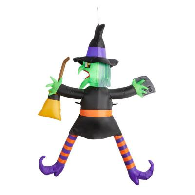 5 ft. Crashing Witch with Spell Book Halloween Inflatable