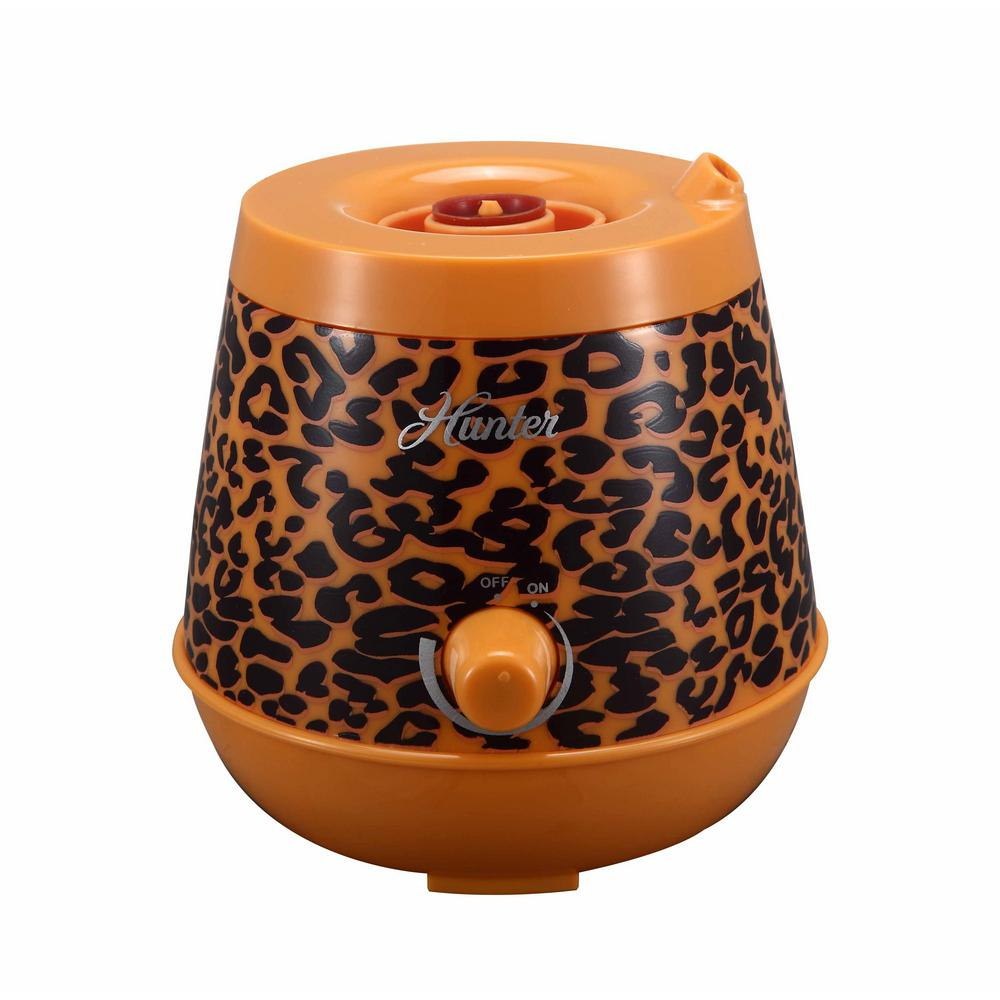 Hunter Personal Ultrasonic Humidifier in Cheeta, Browns/Tans Hunter's Personal Ultrasonic Humidifier is designed to be ultra-portable, allowing you to maintain comfortable and healthy humidity wherever you may need it. Ingeniously designed to use most plastic water bottles as a tank, it is a perfect travel companion as only the base is necessary to bring along in your carry-on. Ultrasonic technology is among the quietest of all humidifiers and the QLS-03 comes in a variety of colors to suit your style and taste to be a welcome addition to any personal space. Color: Browns / Tans.