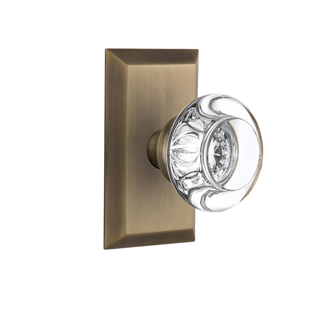 Studio Plate 2-3/4 in. Backset Antique Brass Passage Hall/Closet Round Clear Crystal Glass Door Knob
