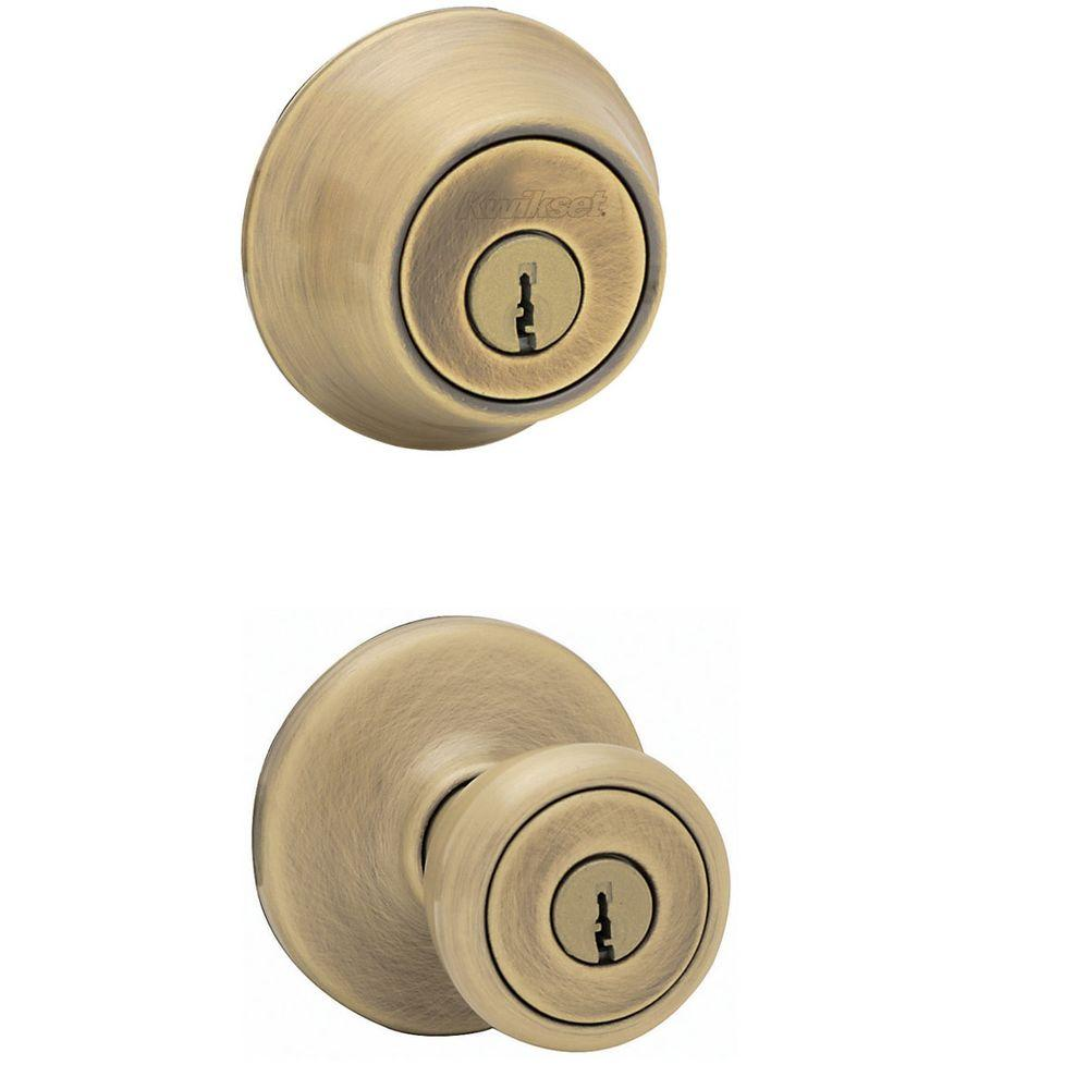 Kwikset tylo antique brass exterior entry knob and single for Front door knobs home depot