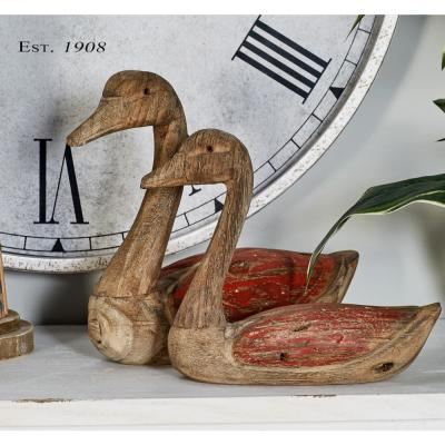 Litton Lane Sitting Ducks Wood Sculpture with Red Highlights (Set of 2)